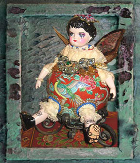 Green Framed Doll